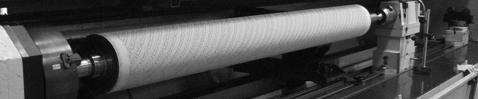 Rubber Roll Being Laser Engraved